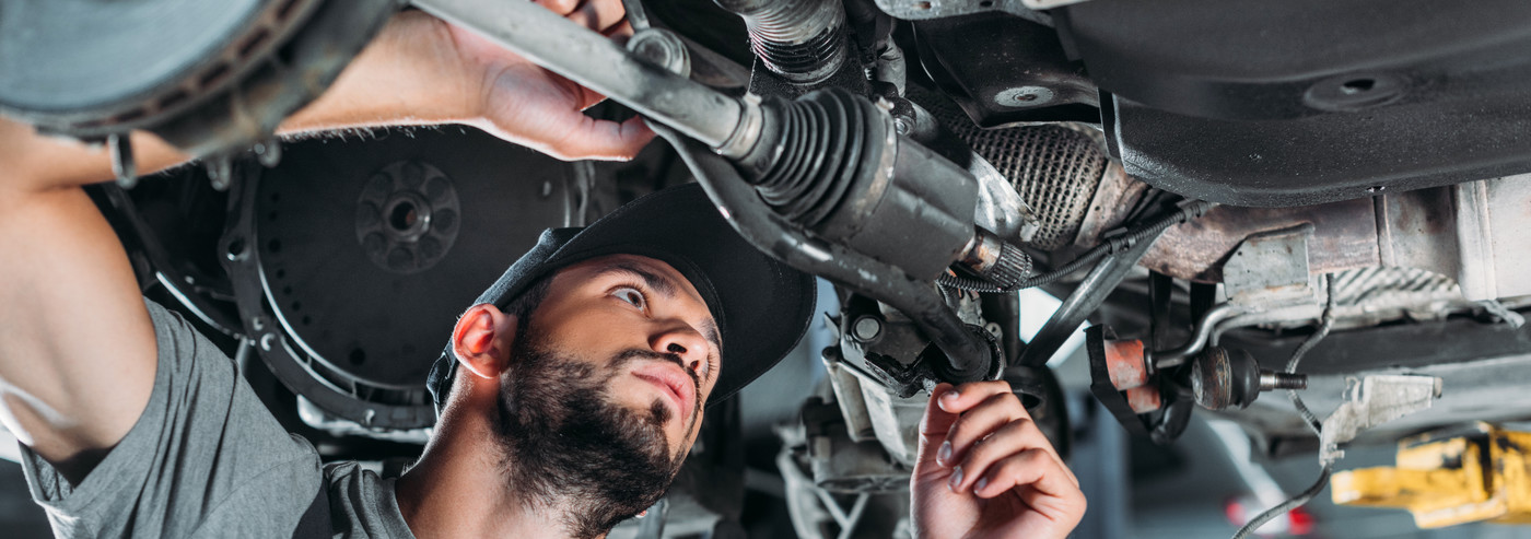 Mechanic looking under a vehicle - Car Repairs Woolwich